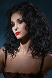 Portrait of sexual girl. Long black hair curls Royalty Free Stock Photos