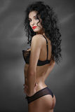 Portrait of sexual girl. Long black hair curls. Stock Photos