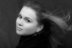 Portrait of the sexual young woman. With developing hair royalty free stock image