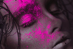 Portrait of sexy adult girl with neon powder on face Royalty Free Stock Image