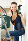 Portrait of sexy beautiful girl  with tools. On staircase in interior Royalty Free Stock Photos