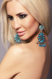 Portrait of sexy beautiful woman with blond hair with bijou. Fashion studio portrait of beautiful glamour model with blond hair and smokey eyes makeup Royalty Free Stock Photos