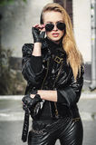 Portrait sexy biker woman in black jacket Stock Photography