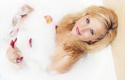 Portrait of Sexy Blond Female in Bath Relaxing. Royalty Free Stock Photography