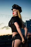 Portrait of sexy blond girl. Dressed as a police Stock Photography