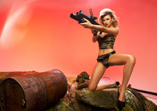 Portrait of sexy blonde  with gun Stock Photo