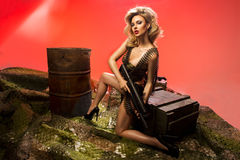 Portrait of sexy blonde  with gun. Sexy blonde woman with rifle Stock Images