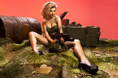 Portrait of sexy blonde  with gun. Sexy blonde woman with rifle Royalty Free Stock Photo