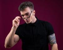 Portrait of sexy bodybuilder took off his glasses Stock Image