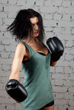 Portrait of sexy boxer girl with gloves on hands Royalty Free Stock Image
