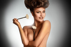 Portrait of sexy brunette with brushes smiling on  Royalty Free Stock Image