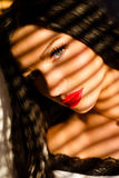 Portrait of sexy brunette female with red lips in Stock Photography