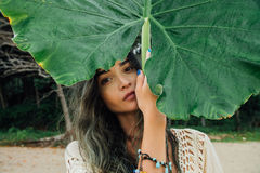 Portrait brunette with palm leaf. Beautiful young woman and big leaf palm. Portrait brunette with palm leaf. Beautiful young woman and big leaf tropical palm stock photography
