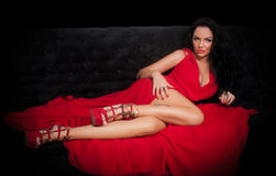Portrait of brunette in red dress Royalty Free Stock Photography