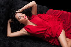 Portrait of brunette in red dress Royalty Free Stock Photo