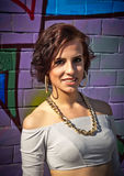 Portrait of sexy brunette swag girl against the background of graffiti Royalty Free Stock Photos