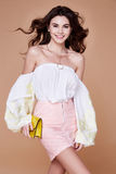 Portrait brunette woman wear skirt pink cotton blouse and s Stock Image