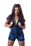 brunette young woman in denim overalls Stock Photos