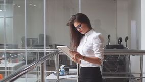 Portrait of sexy business woman in glasses with a tablet stock video