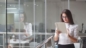 Portrait of sexy business woman in glasses with a tablet stock video footage