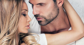 Portrait of sexy couple. Portrait of beautiful couple. Handsome men posing with blonde woman. Love Royalty Free Stock Photography