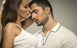 Portrait of sexy couple. On grey background Stock Photos