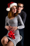 Portrait of sexy couple posing in studio  with present Stock Images