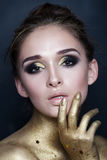 Portrait of Sexy Fashion Woman. Makeup with Gold Stars Stock Image