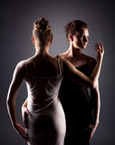 Portrait of sexy female dancers hugging in studio Stock Photography