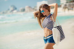 Portrait of girl with beach bag on the beach. Royalty Free Stock Image