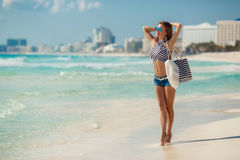 Portrait of sexy girl with beach bag on the beach. Royalty Free Stock Image