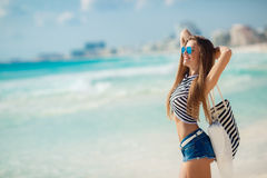 Portrait of sexy girl with beach bag on the beach. Royalty Free Stock Photos