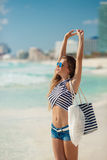 Portrait of sexy girl with beach bag on the beach. Royalty Free Stock Images