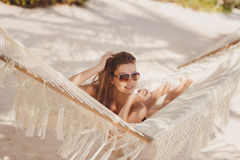 Portrait of a sexy girl in a bikini lying on a hammock Royalty Free Stock Images