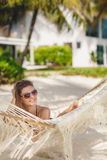 Portrait of a sexy girl in a bikini lying on a hammock Stock Photos