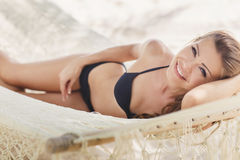 Portrait of a sexy girl in a bikini lying on a hammock Stock Images