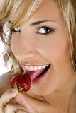 Portrait of a girl. Eating strawberry Royalty Free Stock Photos