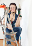 Portrait of sexy  girl in headphones with drill Royalty Free Stock Photos