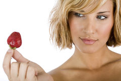 Portrait of a sexy girl holding strawberry Royalty Free Stock Photo