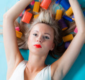 Portrait sexy girl lies on floor with curlers rollers styling hair Stock Images
