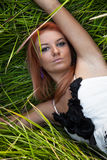 Portrait of sexy girl lying in grass Stock Image