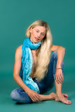 Portrait of girls blonde in jeans and a scarf Royalty Free Stock Images