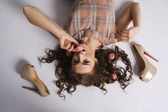 portrait of Sexy glamour brown haired woman with sweet macaron Stock Photography