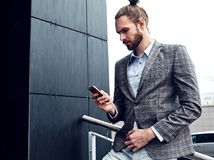 Handsome fashion model man dressed in elegant suit Royalty Free Stock Photos