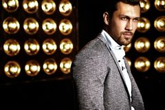 Handsome fashion male model man dressed in elegant suit Royalty Free Stock Photography