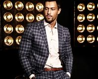 Handsome fashion male model man dressed in elegant suit Stock Photography