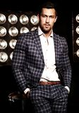 Handsome fashion male model man dressed in elegant suit Royalty Free Stock Photos