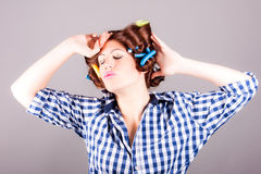 Portrait of housewife with curlers. Attractive housewife with curlers royalty free stock photography