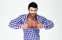 Portrait of a sexy macho unbuttoning shirt Royalty Free Stock Image