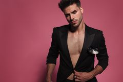 Portrait of man with bare chest buttoning his tux Stock Images